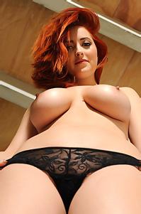 Busty Redhead Lucy Strips